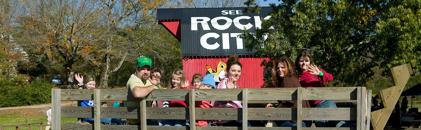 families in front of Rock City barn