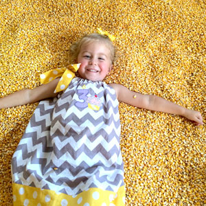 girl-playing-in-corn